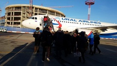 Passengers boarding on the aircraft of airline company Ural Airlines Stock Footage