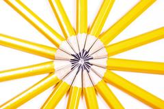 Drawing pencils arranged in a circle creating an abstract sunshine Kuvituskuvat