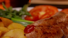 Ketchup drips on grilled sausages Stock Footage