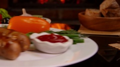 Plate with grilled sausages with ketchup , vegetables Stock Footage