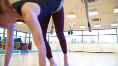 Closeup, girl bends over the hammock to fly yoga Stock Footage