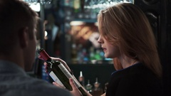 Man and woman wine-tasting in bar Stock Footage