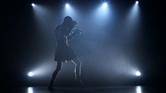 Boxer in the spotlight is trained in studio. Slow motion Stock Footage