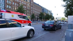 Ambulance car quickly rush along city street with flasher and loud hooter sound Stock Footage
