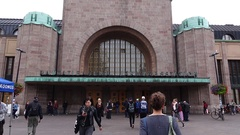 Helsinki Central Railway station entrance at quiet hour, people around Stock Footage