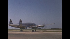 Vintage 16mm film, Super Constellation aircraft taxi and inflight Stock Footage