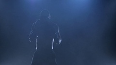 Strong boxer preparing for a fight. Silhouette of a slow motion Stock Footage