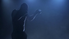 Boxer demonstrates their abilities in sports. Dark studio with smoke Stock Footage
