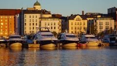 Modern motor boats at marine in very morning time, dawn lighting, calm water Stock Footage