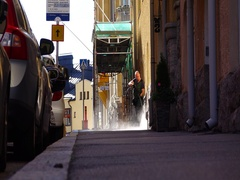 Cleaner man use pressure washer on sidewalk, slow motion candid shot Stock Footage