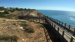 People Walking At High Viewpoint To Ocean In Algarve Area, Portugal Stock Footage
