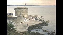 Vintage 16mm film, 1952, Dublin sea wall and harbor Stock Footage