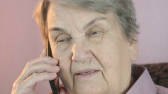 Aged woman talking on mobile smartphone seriously Stock Footage