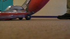 Janitor vacuuming the carpet Stock Footage
