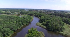 Flying over the forest and the river with lots influx Stock Footage