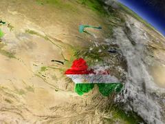 Tajikistan with embedded flag on Earth Stock Illustration