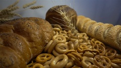 Different bread and ears of wheat close hd Stock Footage