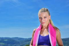 Sweaty fitness woman tired after training. Stock Photos