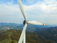 Single wind turbine on the green hill. Stock Footage