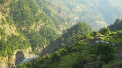 Traditional small nepali village in the mountains in sunset lights Stock Footage