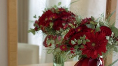 Red bouquet in the mirror on the dressing table Stock Footage