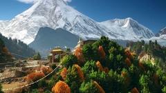 Traditional Buddhist monastery and Manaslu mount in Himalayas, Nepal Stock Footage