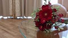 Red beautiful Bridal bouquet lying on the mirror table Stock Footage
