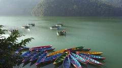 Colour boats on Phewa lake. Pokhara, Nepal Stock Footage