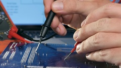 Technician checking motherboard with tester. Technological background Stock Footage