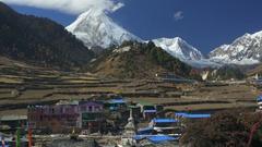 Nepali village in Hymalayas mountains. Nepal. View to Manaslu mount Stock Footage