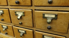 A man searches archive storage filing cabinet system Arkistovideo