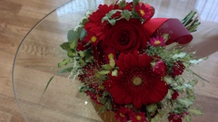 Beautiful red wedding bouquet on the transparent table glass Stock Footage