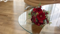 Wedding bouquet on a glass mirrored table Stock Footage