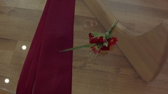 Male attributes. tie, rings, flowers lay on a glass transparent table Stock Footage