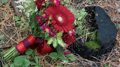 Floral arrangement, bouquet lying on an old stump in the woods Stock Footage