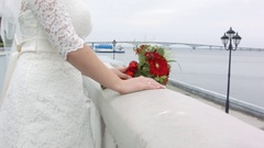 Bridal bouquet. Nice nosegay on granite embankment. Square composition Stock Footage