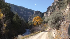 Country Dirt Road in Rocky Mountains Canyon in Fall Scenery Stock Footage