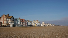 Shingle beach with the town houses overlooking on the foreshore at Aldeburgh Stock Footage