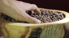 Hands pine nuts on burlap. Stock Footage