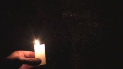 Candle in the dark cave Stock Footage