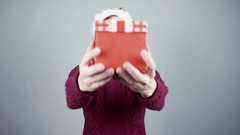 Young man gives a gift. Congratulate New Year, Merry Christmas, presents gifts Stock Footage