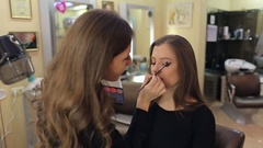 Professional Make-up artist doing make-up to glamour model . Stock Footage