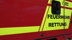 4K Follow ambulance car in rescue mission crowded Munich Marys Square crowd area Stock Footage
