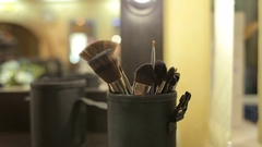 Various makeup brushes. Professional make-up brushes in tube.  Make-up set. Stock Footage