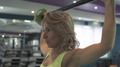 Young beautiful fitness girl exercising in the gym Stock Footage