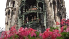 4K Famous Glockenspiel statue Munich tourism attraction town new hall building Stock Footage