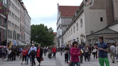 4K Pedestrian people relax in busy shopping area Munich old town attraction shop Stock Footage