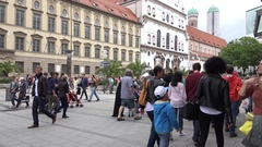 4K Tourist people visit commercial road in Munich downtown crowd busy square day Stock Footage
