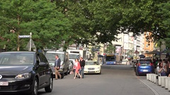 4K Busy traffic narrow street public bus station in Munich central city people  Stock Footage