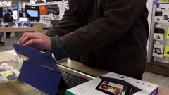 One side of people trying new ipad inside Best buy store with 4k resolution. Stock Footage